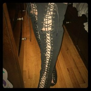 Thigh high peep toe lace ups